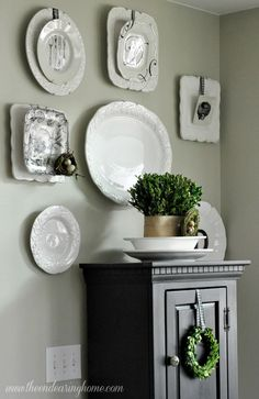 Beautiful plate collection.  Love the birds nests. The Endearing Home