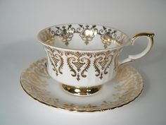 Antique Paragon Tea cup And Saucer, White with gold, Gold scroll tea cup set. by AntiqueAndCrafts on Etsy