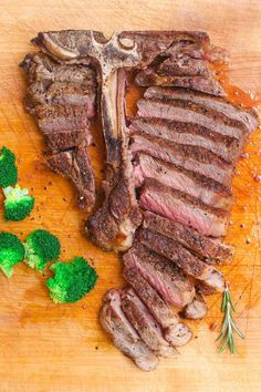 T-bone steak on a cutting board after being prepared for serving by cutting the meat away from the bone and slicing into thin pieces Meat Temperature Chart, Steak Temperature, Cooking T Bone Steak, How To Grill Steak, Grilled Steak Recipes, Meat Recipes, Cooking Recipes, Steak Doneness Chart, Steak Dishes