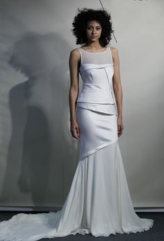 A modern take on the trumpet dress from Amanda Wakely's spring 2013 collection. Carefully-arranged diagonal pleats add visual interest and accentuate the waist and hips – perfect for brides with athletic bodies.