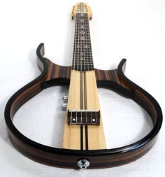 This nice-looking silent hollow body nylon string guitar is designed and made in China by a professional instruments manufacturer, the frame is made of Guitar Diy, Jazz Guitar, Guitar Strings, Acoustic Guitar, Archtop Guitar, Fender Guitars, Guitar Musical Instrument, Types Of Guitar, Cigar Box Guitar