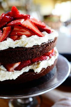 Putting a Small flag or flags on top would make it darling for Memorial Day, the 4th, or Labor Day.  Chocolate nutella strawberry cake .via the Pioneer woman.com