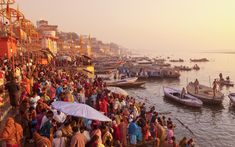 20 great things to do as the sun rises - Take a boat along the Ganges, Varanasi, India Glide through the sacred waters as India's holiest and oldest city eases itself into the new day. Bathed in an orange glow, the flights of stone ghats that … Varanasi, Kashmir Tourism, Rio, Best Sunset, World Photo, Tourist Places, Cool Places To Visit, Travel Inspiration, Around The Worlds