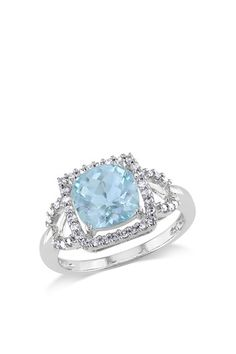 Blue Topaz and Diamond Ring.