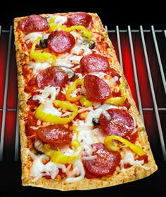 Thin Crust Pepperoni Pizza  1 Flatout® Thin Crust Flatbread Spicy Italian  3 Slices Provolone cheese  12 slices pepperoni  ¼ cup red sauce  ¼ Cup Shredded Mozzarella  8 Slices Banana Pepper Rings
