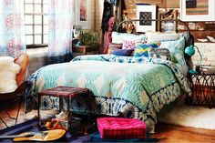 Indie inspired bedroom. I am in love with the comforter!!