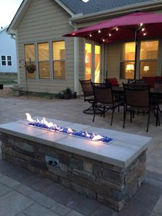 Gas fire pit on our Techo Bloc paver patio project. The 4' linear gas fire trough features Cobalt Blue reflective fire glass.