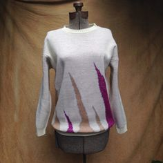 """Vintage Oversized 1980s Sweater Sparkle Geometric. Dive into the 80s  Details Size: """"3"""" Shoulders: 22"""" Chest: 42"""" Sleeve: 18"""" Length: 28""""  Brand: unmarked, made in USA, 93% acrylic, 7% mylair Color: off-white, magenta, silver grey, gold, tan"""