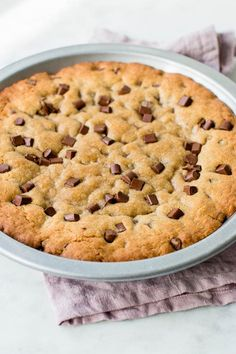 The best super soft, thick, and chewy chocolate chip cookie cake. It tastes amazing and is loaded with chocolate chips. It's perfect as a birthday cake!