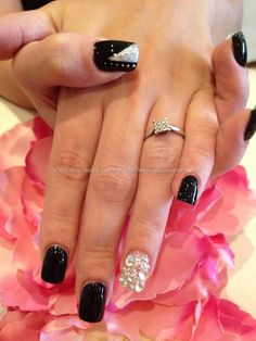 Black polish with Swarovski crystals and freehand nail art