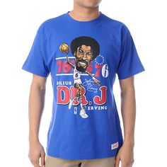 "Julias Erving or ""Dr J"" was one of the most exciting players back in the day and was known for his athletic dunks. Celebrate the career of the great Julias Erving caricature tee shirt. This is a guys short sleeve blue tee shirt from Mitchell & Ness, featuring a Julias Erving caricature and DR J script over the Philadelphia 76ers logo on the chest, with a Mitchell & Ness brand tag at the bottom. Even if you can't dunk from the free throw line you can still ball in the Julias Erving caricature…"