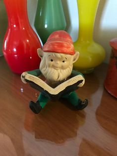 A personal favorite from my Etsy shop https://www.etsy.com/listing/562364268/vintage-ceramic-homco-elf-reading-book