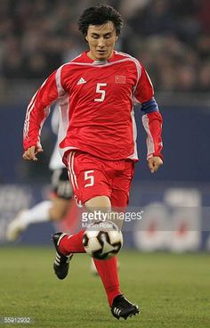 Wei feng LI of China runs with the ball during the friendly game between Germany and China at the AOL Arena on October 12 2005 in Hamburg Germany