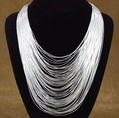 """75-Strand-Liquid-Silver-Waterfall-Necklace -  A rippling waterfall of Liquid Sterling Silver - Seventy-five strands of lustrous tiny Silver beads hand strung and gathered into graceful Silver cones. Strung by Navajo master bead artist Berlinda Begay. Can you imagine that this silver waterfall necklace has over fourteen thousand individual pieces in it. Twenty-four inches of soft flowing Sterling Silver to drape around your neck. This Liquid Silver Necklace is 24"""" long. Stamped Sterling"""