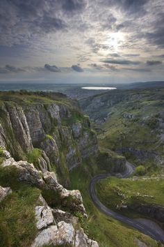Cheddar Gorge, Cheddar. Britain's biggest gorge from the dramatic cliffs rising 450ft to the stunning stalactite caverns. This world-famous beauty spot is a National Nature Reserve, reveals many fascinating stories of our prehistoric ancestors, and is an international centre for caving and rock climbing.