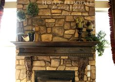 the photographer made the mantel and hired someone to put stone in for an affordable price.