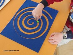 Interesting idea for little fingers. Take a felt sheet and cut out a spiral. Now you can use it as a labyrinth with a little ball. The cut-out spiral part can also be used for tracing with fingers http://www.ecolesenfantines.ch/liste-grapho/409-ateliers-autour-de-la-spirale-2