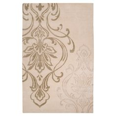 New Zealand wool rug with an oversized medallion motif. Hand-tufted in India.   Product: RugConstruction Material: 1...