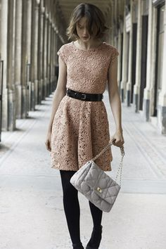 Nude lace dress, black belt, tights and pumps.