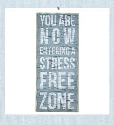 Stress Free Zone sign. You Are Now Entering a Stress Free Zone. Weathered and rubbed wood creates wall art that looks aged from wind, sand and sun for a beach cottage style. Designed in a box style to allow for either wall hanging or sit atop a shelf or table.