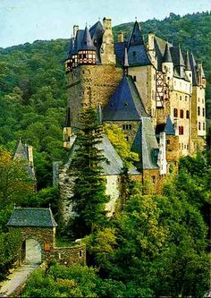 Burg Eltz Castle is a towering medieval structure located in a lush forest in the Lower Moselle Valley near Koblenz