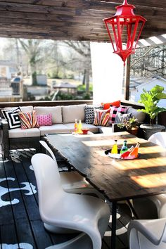 Outdoor inspiration. I actually like this a lot! Painted floor, colorful pillows.