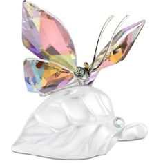Swarovski Sparkling Butterfly on Leaf: This butterfly in faceted Crystal Aurora. daintily flits over a frosted crystal leaf. Add good luck and natural beauty to your home with this piece Glass Figurines, Collectible Figurines, Swarovski Crystal Figurines, Swarovski Crystals, Faceted Crystal, Swarovski Ornaments, Swarovski Butterfly, Vases, Accesorios Casual