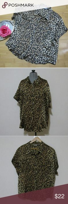 Chicos Silk Leopard ShortSleeve Dolman ButtonDown Features: collar, short sleeves,  two flap buttoned pockets,  rounded hem, 6 total body buttons, 2 total pocket buttons,  tapered back  Materials:  100% silk  Measurements:  Length:  28.5 inches  Bust: 50 inches Sleeve Length: 6.25 inches  Condition:  great gently pre-owned with no flaws   Occasions:  casual,  wear to work, wear to bars after work Chico's Tops Blouses