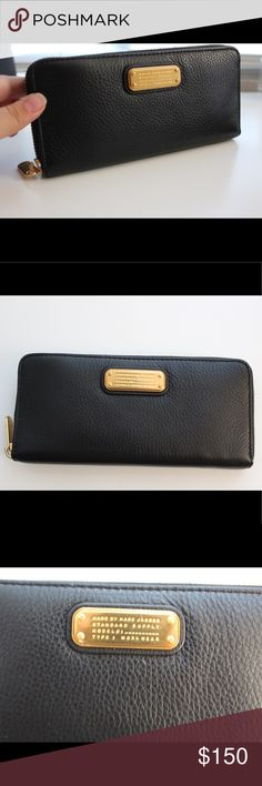 "New Q slim continental leather wallet black Genuine pebbled leather with gold tone accents in a classic slim rectangular shape. Top zip closure, exterior features branded metal plate, interior features 1 center divider zip pocket 8 card slots and 2 bill slots approx 3.75"" H x7.75 W X11"" D Marc By Marc Jacobs Bags Wallets"