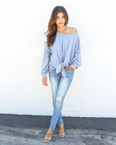 We're loving our Knot Your Sweatshirt pull over! This statement piece is ultra soft and comfortable in heather grey and long sleeves. This essential can be worn off one shoulder, off both shoulders or