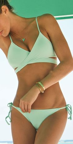 Pastel Green Crossover Triangle Bikini Suits come in mint green color, makes you looking fresh and cool at hot summer beach Details: - Mint green - Crossover design - Fabric: Polyester+Spandex Ties at