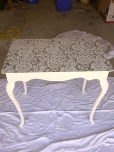 Old table from a thrift store.  Sand, paint, lace treatment = My custom make-up table!