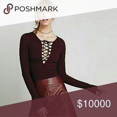 Wine Red top Gorgeous top! Great with a number of outfits!BRAND IS NOT AS LISTED: (Brand only for exposure) Free People Tops