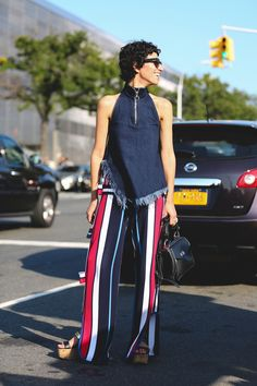 100+ Outfits We're Copying From The Streets Of New York City #refinery29  http://www.refinery29.com/2016/09/120553/nyfw-spring-2017-best-street-style-outfits#slide-119  Frayed denim on stripes, what more could you really want out of an outfit?...