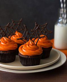 Halloween Pumpkin Chocolate Spiderweb Cupcakes These pumpkin Halloween cupcakes combine pumpkin-chocolate cake with spiced cream cheese frosting & chocolate spiderweb toppers for a fun Halloween dessert!