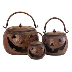 Set of three decorative iron Jack O' Lanterns with weathered copper finishes and hammered details. Prefect for Halloween and you can use them year after year.