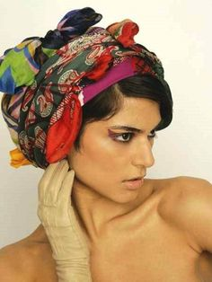 Wonder how this looks on me? When I put my basket of scarves on my head...I 'll try!