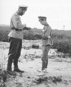Alexei and Nicholas Romanov circa 1916.  Wonder what they're looking at.