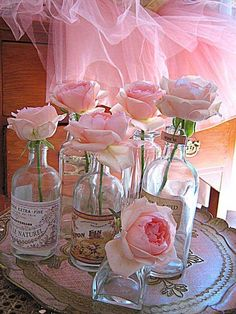 Pretty pink roses in vintage bottles