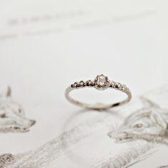 Image of platinum rose-cut diamond semi-eternity ring