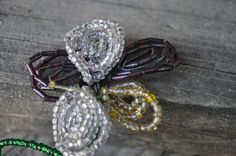 Victorian-style glass beads and wire flower via Etsy