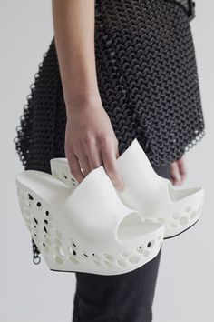 News: designer Janne Kyttanen has created a range of 3D-printed shoes for women that can be made at home overnight to be worn the next day.