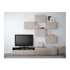 IKEA - BESTÅ, TV storage combination, black-brown/Selsviken high-gloss/beige, drawer runner, push-open, , The drawers and doors have integrated push-openers, so you don't need handles or knobs and can open them with just a light push.The space-saving wall cabinets make the most of the wall area above your TV.It's easy to keep the cords from your TV and other devices out of sight but close at hand, as there are several cord outlets at the back of the TV bench.The cable outlet at the top lets…