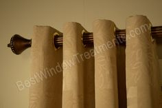 """Custom Grommet Draperies on extra long wood curtain rod in 1 3/8 inch diameter - can be ordered over 150"""" inch extra long - nice cream color with damask print"""