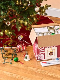 Christmas storage idea: Start by packing away decorations in customizable storage that doesn't cost a thing, such as the liquor-store castoff shown here. Tape an old holiday card onto each box, so you can easily spot it in the attic or basement, and add a label. That way, you don't have to look through 10 boxes just to find the tree topper.