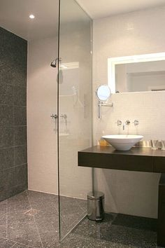 Small bathroom @Renae @ CreativeChicksatPlay (This is a great way to do the floor tile. Use the glass to keep the water in the shower area.)