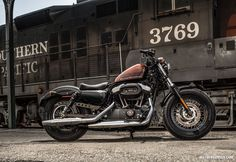 Imagine riding to Sturgis on this bad boy....the Sportster Forty Eight 2014 Harley Davidson. I'm becoming such a moto!!!!