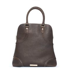 Edgy style magazine Addikted to Fashion featured this look, a contemporary-goth take on the trusty carpet bag.