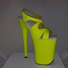 Stunning 8 inch heel custom made shoes made with genuine uv reactive leather in yellow color. Also available in pink and orange leather and on 6,7,7 1/2,8 and 9 inch heels.