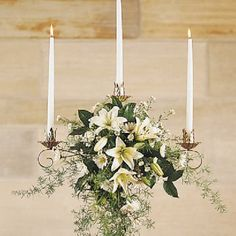 Flowers for Wedding Candelabras; You'll love browsing this site!  Filled with hundreds of photos, there are ideas for churches, bride flowers, attendents, reception venues & theme suggestions.